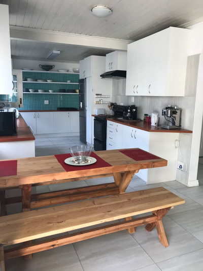 Full kitchen and open plan to dining table